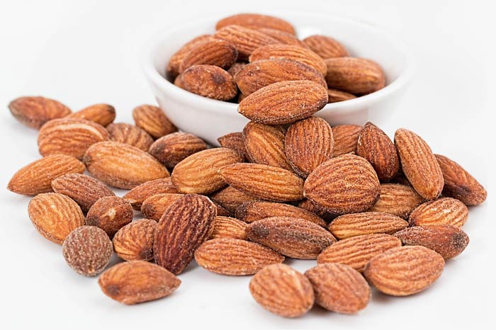 roasted almonds in a cup